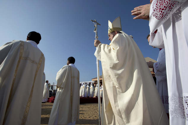 Pope Francis, center right, holding his pastoral staff, arrives in the seafront Galle Face Green for the canonization ceremony of Joseph Vaz, in Colombo, Sri...