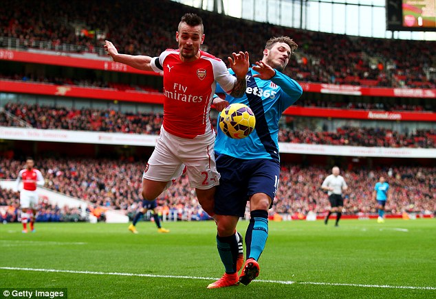 Mathieu Debuchy dislocated his shoulder after colliding with Stoke's Marko Arnautovic in the 3-0 victory