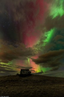 Christ Redeemer Appears In Aurora Borealis