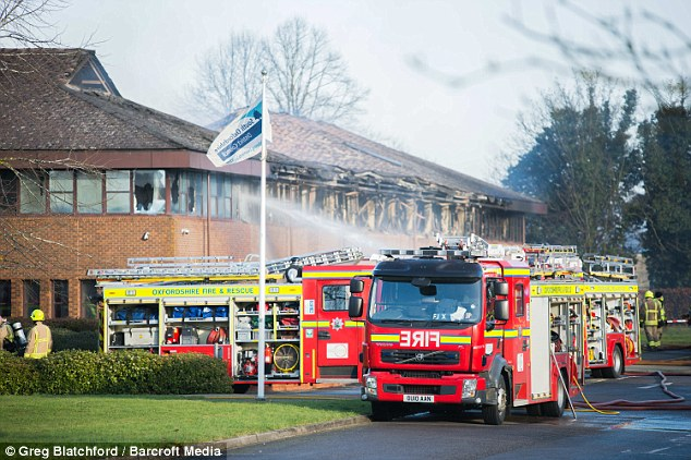 Dozens of crews remained at the South Oxfordshire District Council offices , which was devastated by the fire