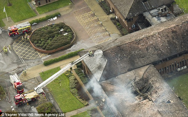 The roof of the council building caved in and crews were using aerial ladder platforms to assess the site