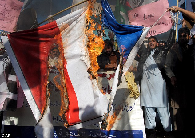 Protesters burned represenations of French flags as Pakisatani officials tried to get them under control using tear gas, batons and water cannons