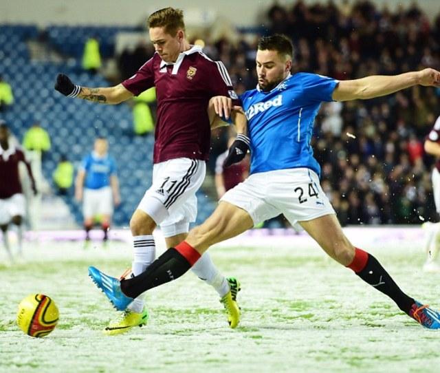 Rangers Defender Darren Mcgregor Right Tackles Hearts Sam Nicholson On A Snowy Night