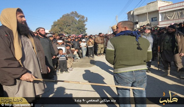 Pictures show the men being beaten on their backs and legs by tribal elders in a public square believed to be inBujaq, a town to the north east of Aleppo