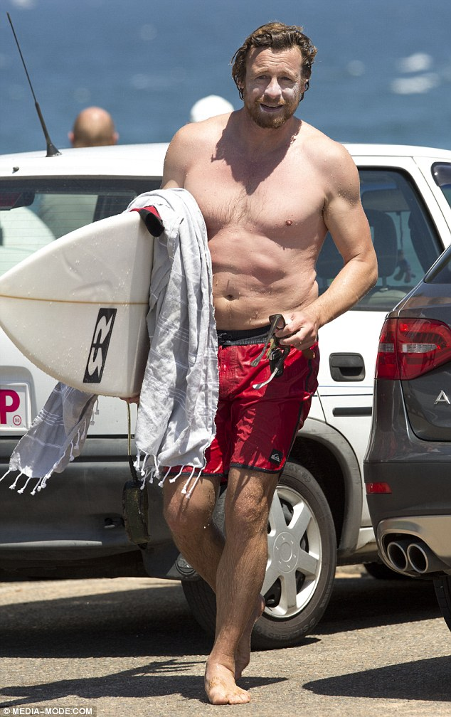 Simon Baker Shows Off His Chiseled Torso As He Rides Some