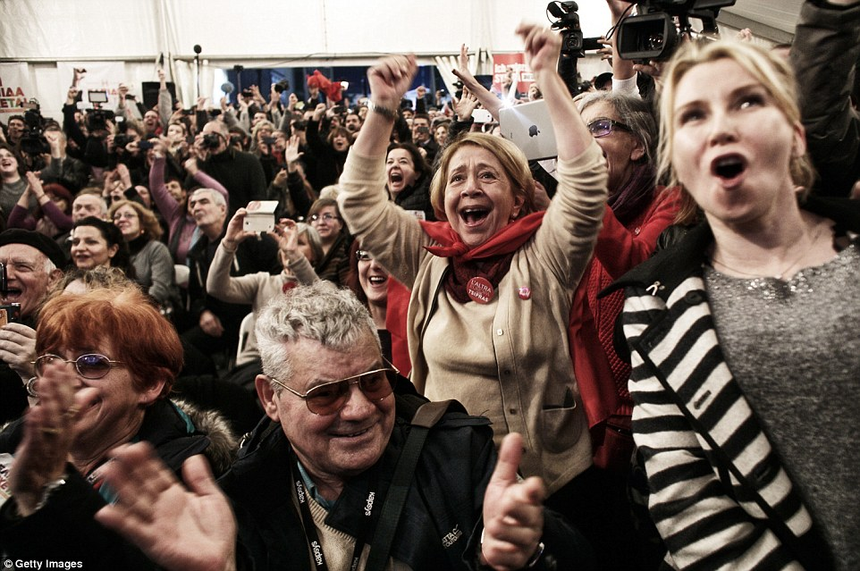 Jubilant: Syriza supporters celebrate victory in the Greek general election, in which the anti-austerity party triumphed over ruling conservatives