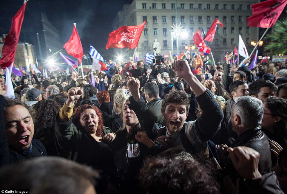 Cheering: Syriza's supporters celebrated having an estimated 36 per cent of the vote, compared to the conservatives' 28 per cent