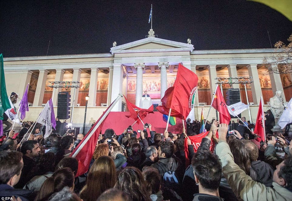 Jubilant: Syriza supporters waved everything from rainbow flags to those bearing Communist symbolism as they heard of their victory