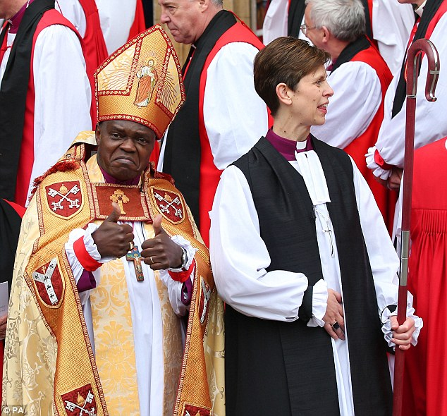 Support: The Archbishop of York, John Sentamu, gives a thumbs-up sign outside the cathedral