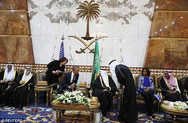 Sidelined: Mrs Obama appears left out of the conversation in this picture of the First Lady and president visiting Saudi Arabia on Tuesday