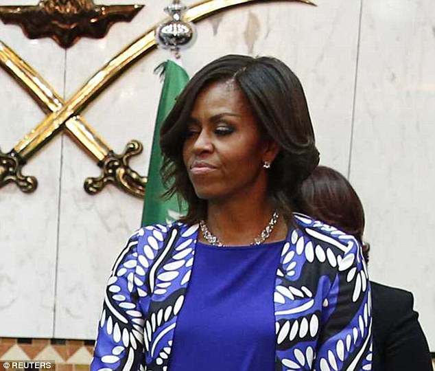 Passed over: Mrs Obama glared as a Saudi delegate passed her by and refused to shake her hand after greeting her husband