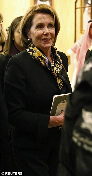 House Minority Leader Nancy Pelosi (pictured) and former Secretary of State Condoleezza Rice were two other women in the American delegation visiting Saudi Arabia, but attracted little attention in their neutral all-black outfits