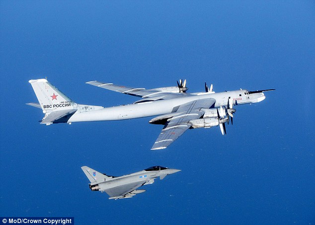 Off you go: A Russian Bear is escorted by an RAF jet during an alert in September. (File picture)