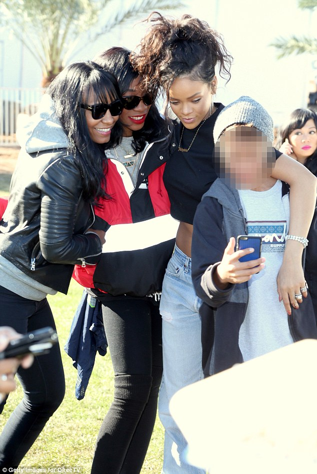 Meet and greet: Rihanna happily posed with three fans, one of whom took a selfie