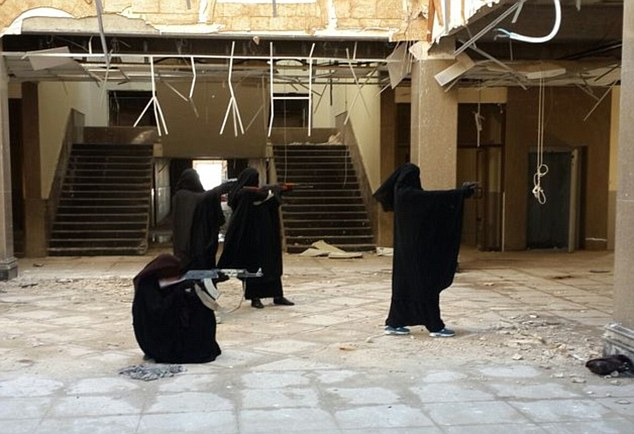 Trained to kill: One of the Halane twins, who fled to Syria to marry ISIS fighters, tweeted this picture with the caption: 'Fun day training for self defence in the Islamic State with humble sisters'