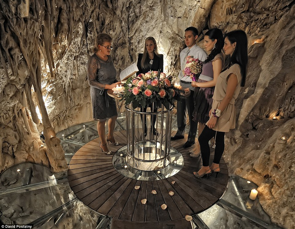 Do look down: A bride and groom tie the knot in the cave, surrounded by stalagtites and with the sea beneath