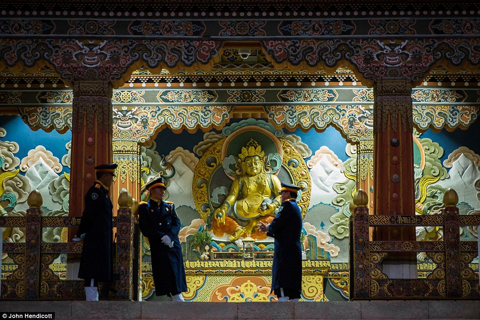 Guards on duty at Tashichhodzong, Thimphu. The country is known for its natural scenic and cultural highlights and its welcoming people