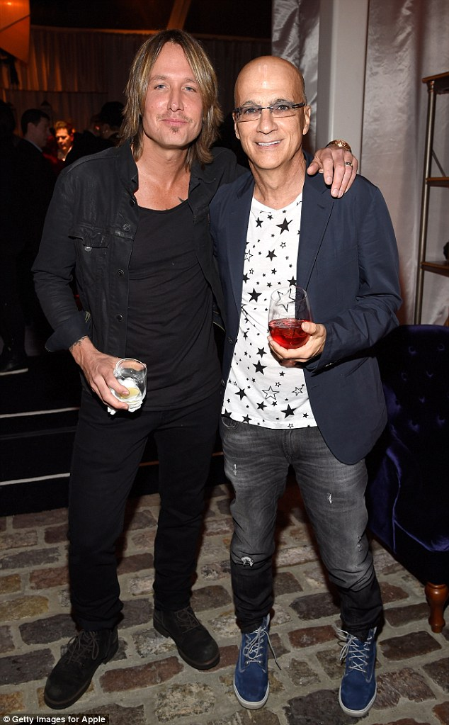 Winners are grinners: The singer poses for a photograph with James 'Jimmy' Iovine at the honorary party in Beverly Hills