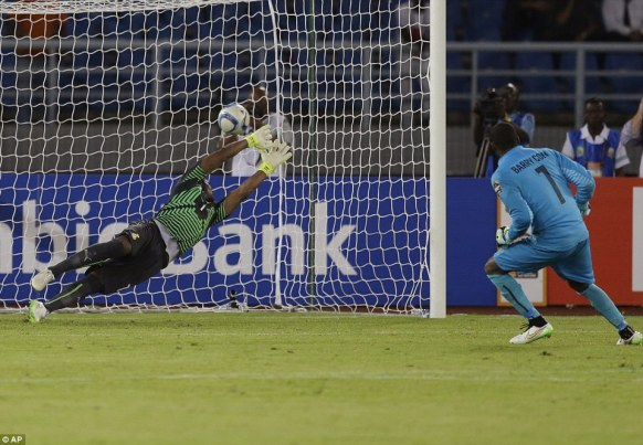Ghana's goalkeeper Razak Braimah dives as he fails to save the winning penalty from Ivory Coast's goalkeeper Boubacar Barry
