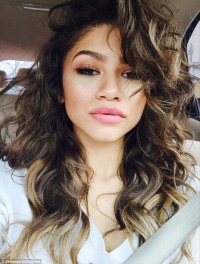 Zendaya dons pixie-cut wig and Vivienne Westwood gown at ...