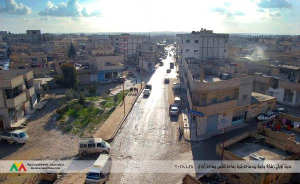 The same busy road is seen before ISIS' bombardment of Kobane, which has left the majority of the city in ruins