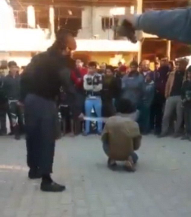 Cruel: The video, purportedly in Iraq, shows a large crowd in the town square watch as the boy is punished
