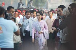 Myanmar opposition leader Aung San Suu Kyi attends a ceremony marking the centenary of the birth of her independence hero father Aung San, in the town of Nat...