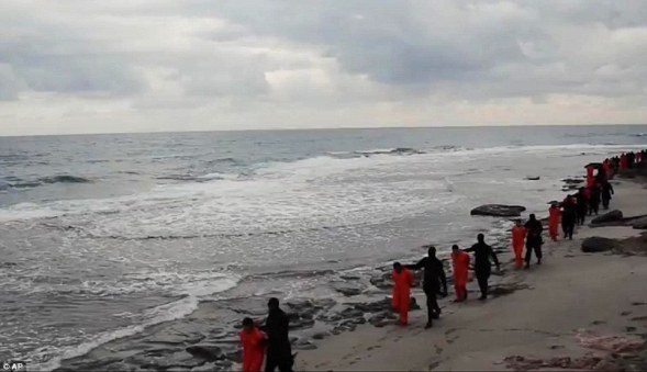 To their deaths: The Christian hostages are seen being marched along the beach before the beheadings