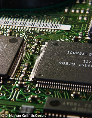 Scientists used an 'error correction' similar to those found in laptops (stock image). This involved adding data to each fragment to create back ups