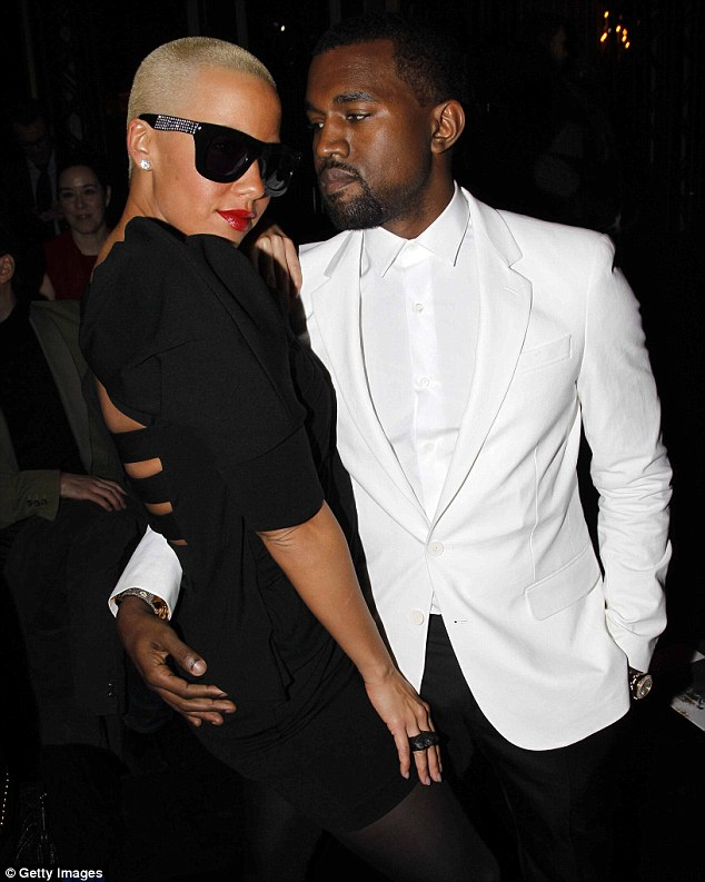 Former flame: Amber and Kanye dated several years ago. They are pictured here in January 2010