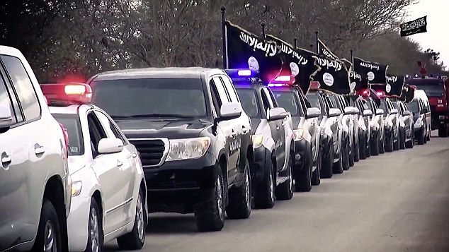 Procession: A fleet of cars parade freely through the Libyan city of Benghazi, showing the level of control they exercise in the country ruled almost entirely by rebel forces