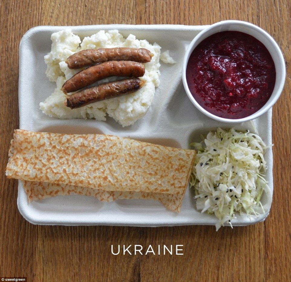 A serving of borscht (beetroot soup) with pickled cabbage, sausages and mash. Dessert is a sweet pancake