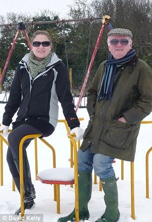 Julia enjoys the snow at a nearby park with her father after the accidents
