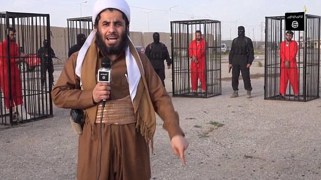 El último video de ISIS muestra un militante entrevistar rehenes kurdos por delante de sus puertas presumiblemente sombrías