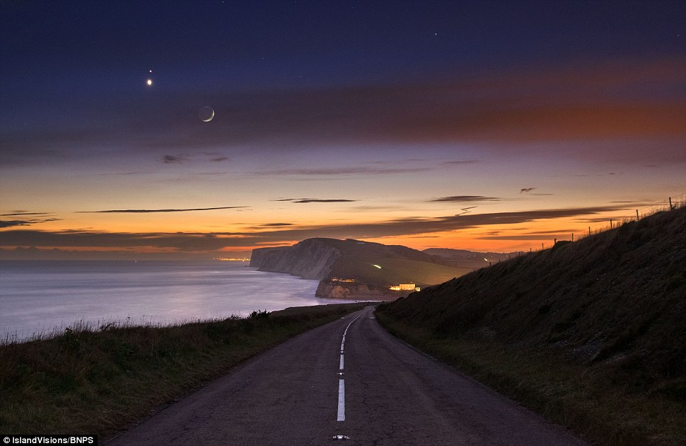 Stunning scene: The red dot of Mars just above the brighter Venus, with the moon to the right on the Isle of Wight