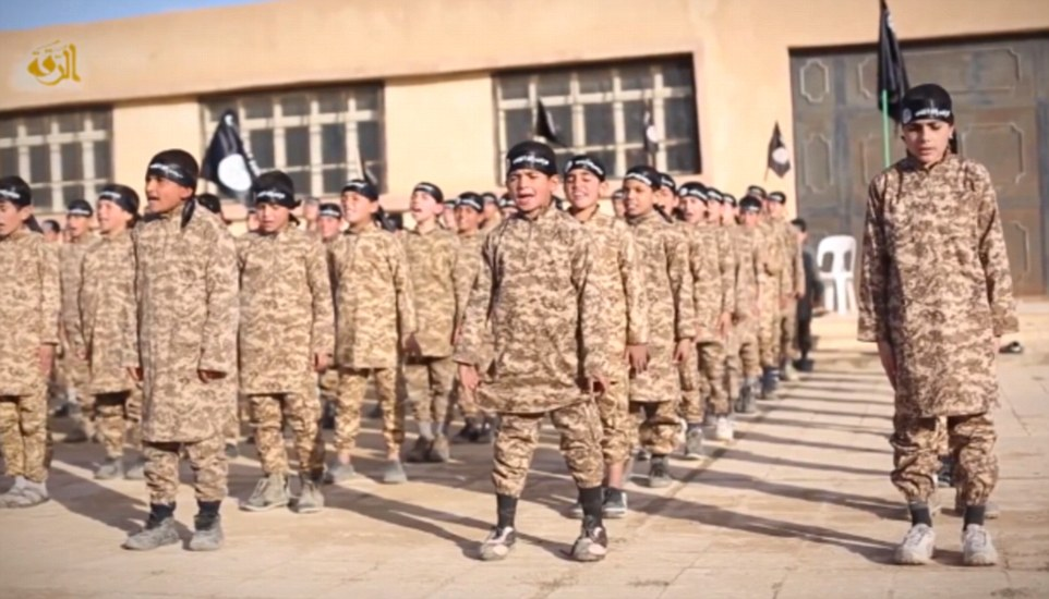 In the nine-minute video, children in camouflage are seen being trained at the Farouk Institute for Cubs, in the Raqqa province in Syria