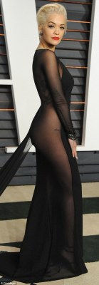 Little to the imagination... Rita's outrageous floor-length gown showed off her curves - as well as her tattoo