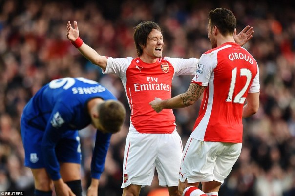 Rosicky and GIroud, Arsenal's two goalscorers, celebrate the former's strike in the dying minutes against visiting Everton