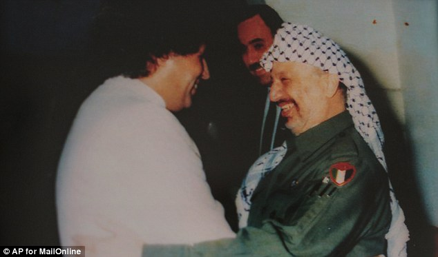 Trusted: Gaddaf al-Dam was his cousin's Sepcial Envoy and met world leaders for the regime. Here he is pictured with Palestine's Yasser Arafat