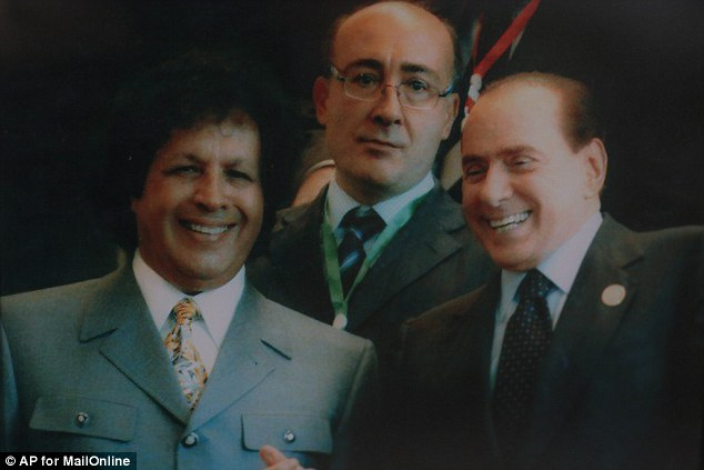 Jibe: Of Silvio Berlusconi, Italy's former premiere, Gaddaf al-Dam said he is a 'good guy'. But remembers: 'He used to be our friend... then he bombed us. Pointing to Berlusconi's community service sentence for tax fraud, he joked: 'Now he is sweeping the streets of Rome'