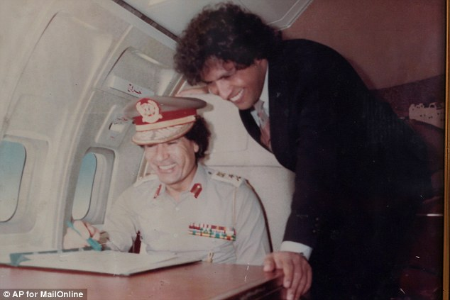 Blood: Gaddaf al-Dam is still extremely loyal to his cousin, deposed despot Col. Muammar Gaddafi (pictured together above). He hopes to wield his influence so his clan can help shape the future of Libya