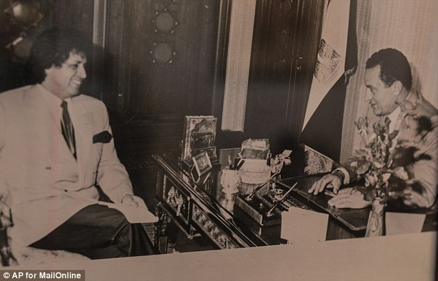 Influence: Gaddaf al-Dam pictured at a meeting with former Egyptian president Hosni Mubarak
