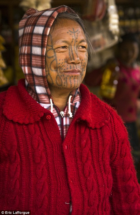 Delicate: Women of the Chin tribe have smaller and more delicate tattoos that only cover part of the face