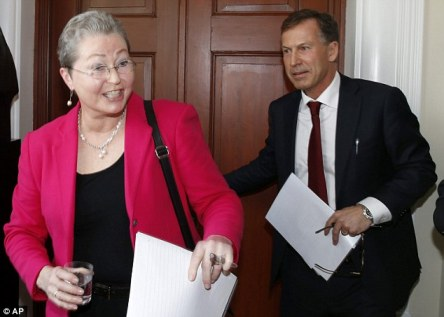 Newly appointed chair of The Norwegian Nobel Committee, Kaci Kullmann Five (pictured left) and secretary of the committee Olav Njolstad (right) arrive for a press briefing at the Norwegian Nobel Institute in Oslo