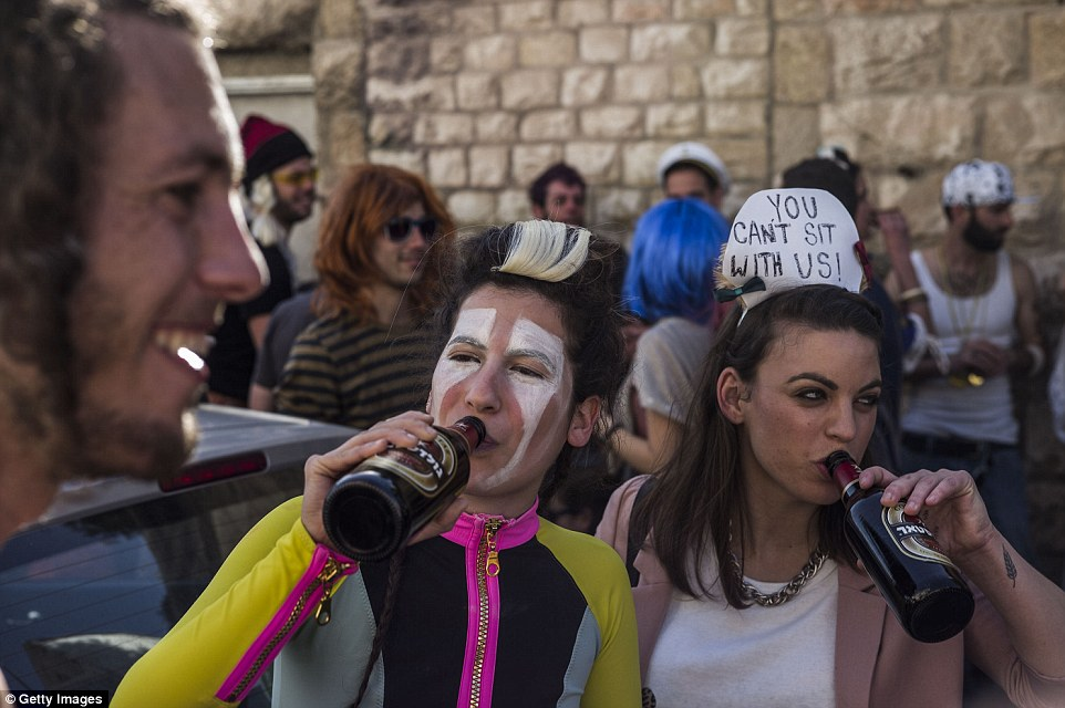 Ultraorthodox Jewish men gather to dance in Jerusalem as thousands in fancy dress take to the