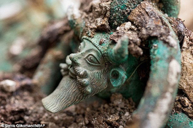 The biggest find at the site was a huge wine cauldron.Standing on the handles of the cauldron, is the Greek god Acheloos. The river deity is shown with horns, a beard, the ears of a bull and a triple mustache