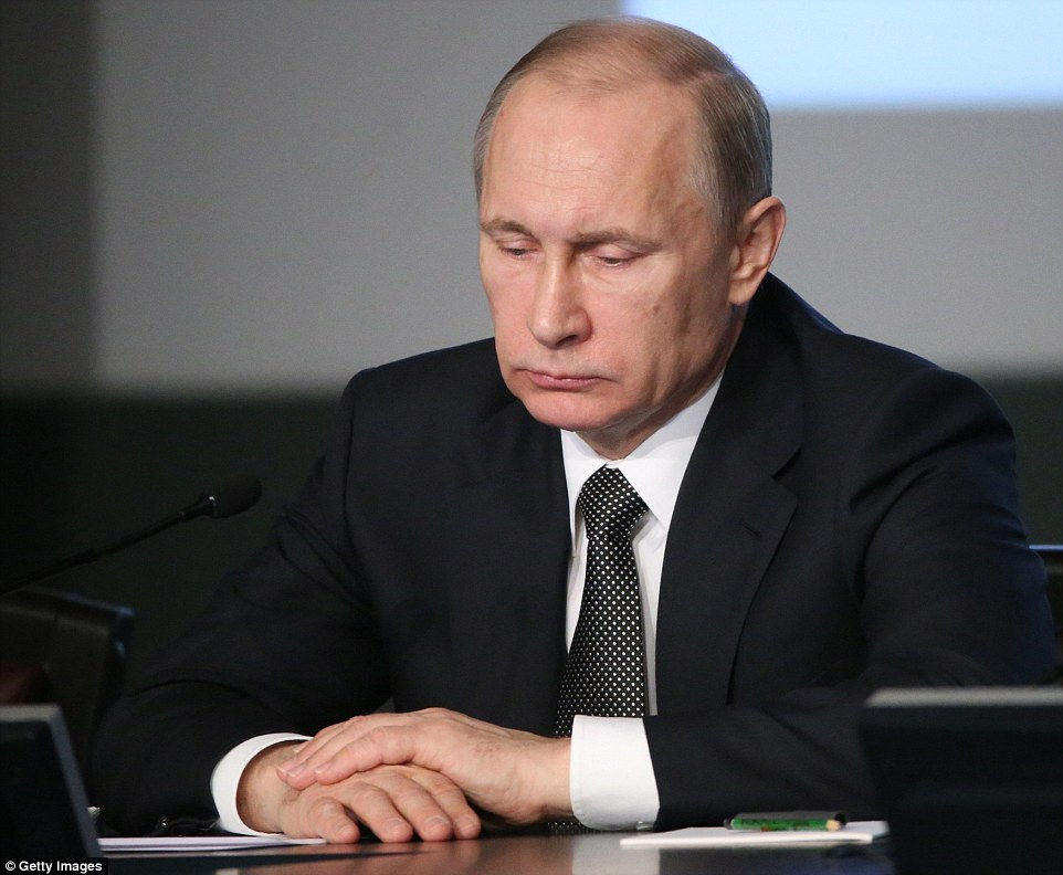 Russian President Vladimir Putin attends an annual expanded meeting of the Interior Ministry's Board on March 4. He said: 'The most serious attention should be paid to high-profile crimes, including the ones with a political subtext'