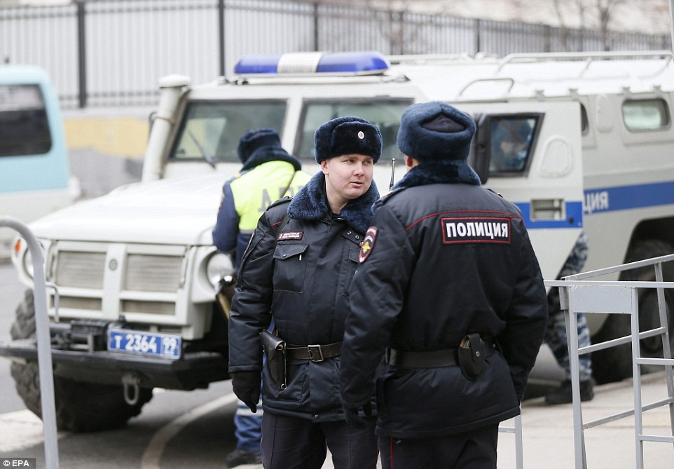 Russian police guard the yard of Basmanny district court, in Moscow, where the suspects in the killing of Mr Nemtsov were delivered