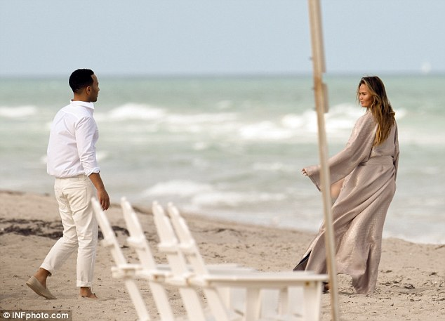 Follow me: The beauty seemed to beckon her man in front of the spectacular backdrop of Miami Beach