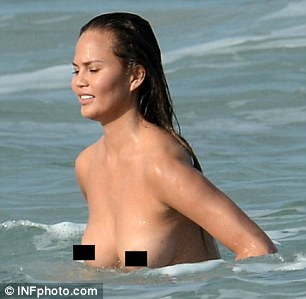 Not shy: Chrissy appeared proud of her body as she waded through the waves